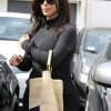 http://www.celebdirtylaundry.com/2014/kim-kardashian-looking-pregnant-weight-gain-baby-bump-and-pregnancy-bloat-photos/