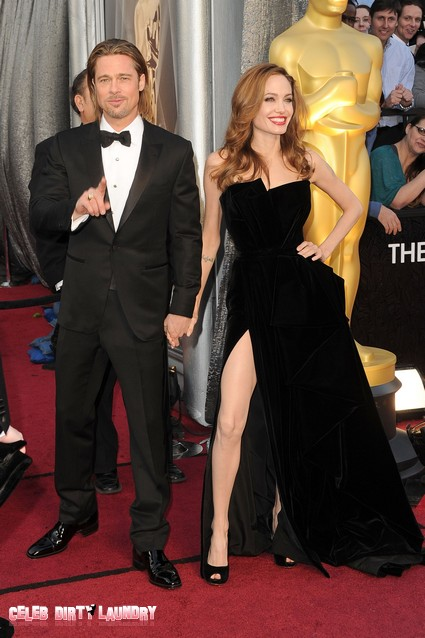 Report: Angelina Jolie Pretends She Is Above 'Jolieing' Leg Pose Gossip