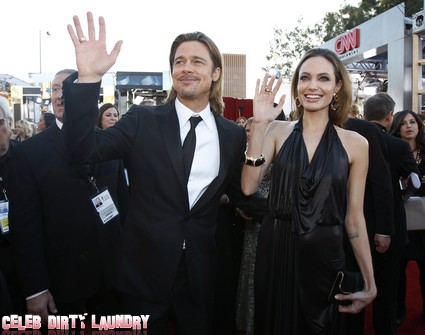 Actors Brad Pitt and Angelina Jolie arrive at the 18th annual Screen Actors Guild Awards in Los Angeles