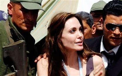 Angelina Jolie And Tattoo Makes Seven??