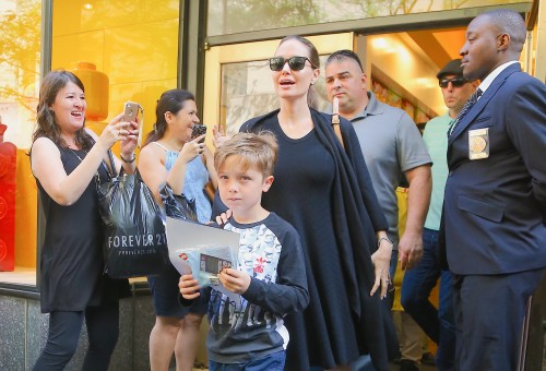 Angelina Jolie & Her Son Knox Shop At The Lego Store In NYC