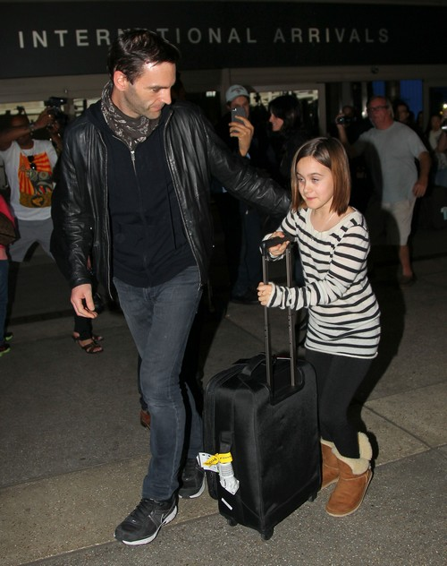 Courteney Cox Arriving On A Flight At LAX With Coco & David