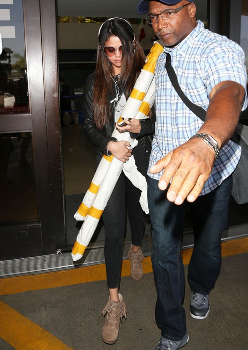 Selena Gomez Touches Down At LAX