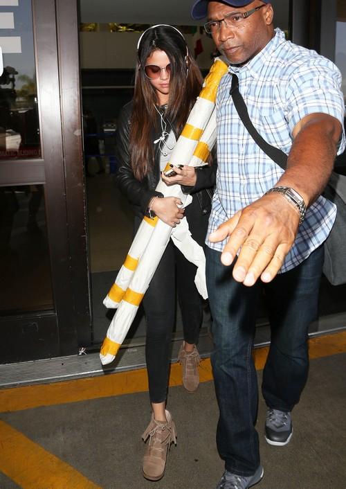 Selena Gomez Touches Down At LAX