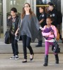 Angelina Jolie And Kids Arriving On A Flight At LAX