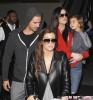 Khloe & Kourtney Kardashian Land At LAX