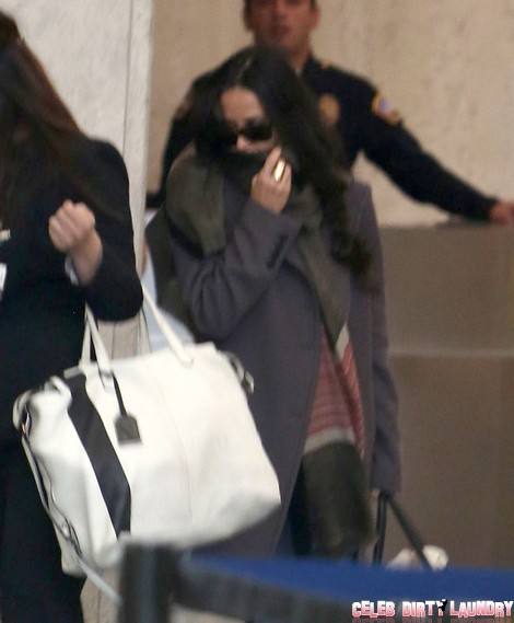 Demi Moore Arriving On A Flight At LAX