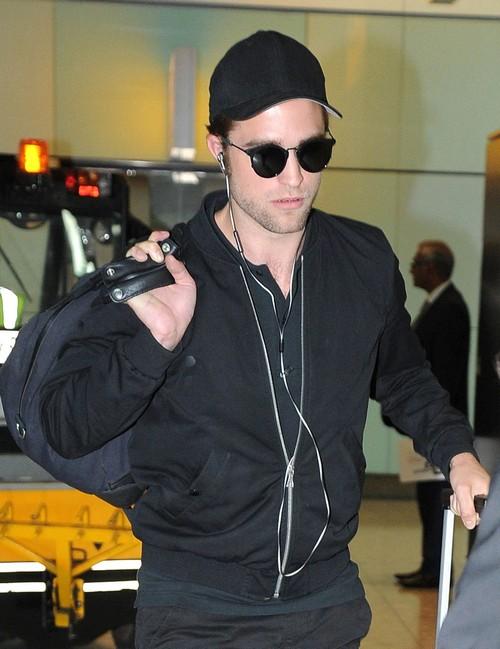 Robert Pattinson Lands In London