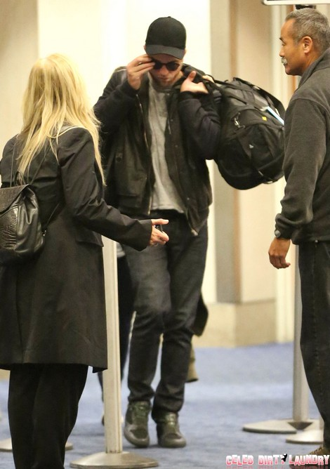 Robert Pattinson & Kristen Stewart Arriving On A Flight At LAX