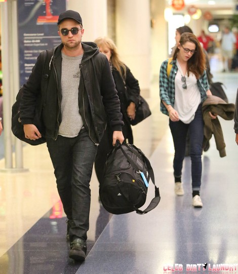 Robert Pattinson & Kristen Stewart Arriving On A Flight At LAX