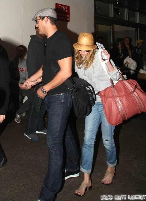 Leann Rimes and Eddie Cibrian Take Cover at LAX