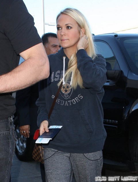 Carrie Underwood & Mike Fisher Departing On A Flight At LAX