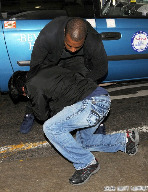 Kanye West Tussles With A Photographer At LAX