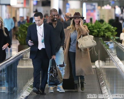 Exclusive... Hot-Tempered Kanye West Greets Photogs With Evil Stares During Layover at San Francisco Airport - NO WEB USE