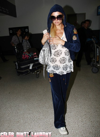 Paris Hilton Arrives At LAX From France & Gets Mobbed By Photographers
