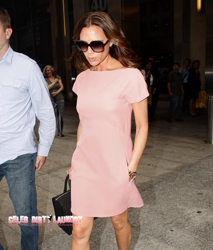 Victoria Beckham Admires Russell Brand's Style