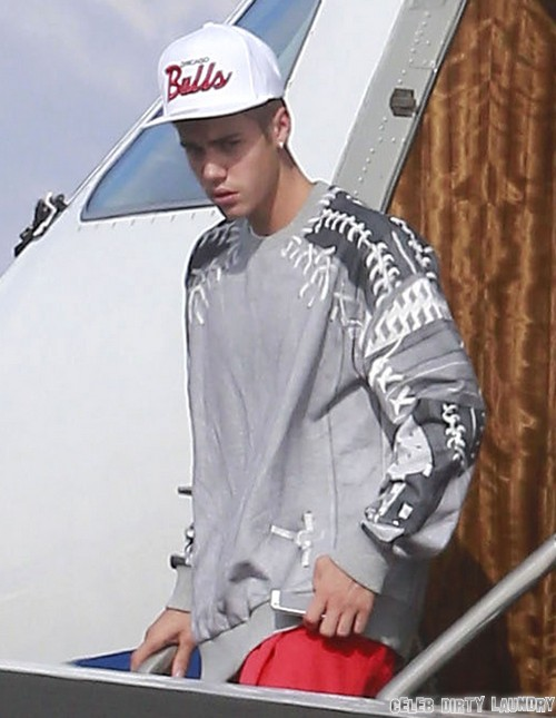 Justin Bieber Looks Angry and Miserable Leaving Private Jet - Jonesing For Something? (PHOTOS)