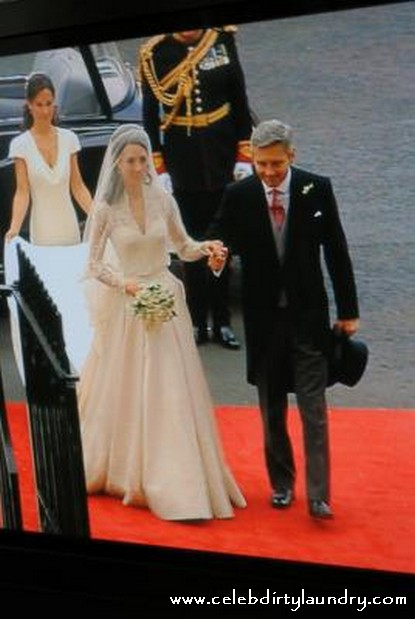 kate middleton dresses. Kate wedding dress is an ivory