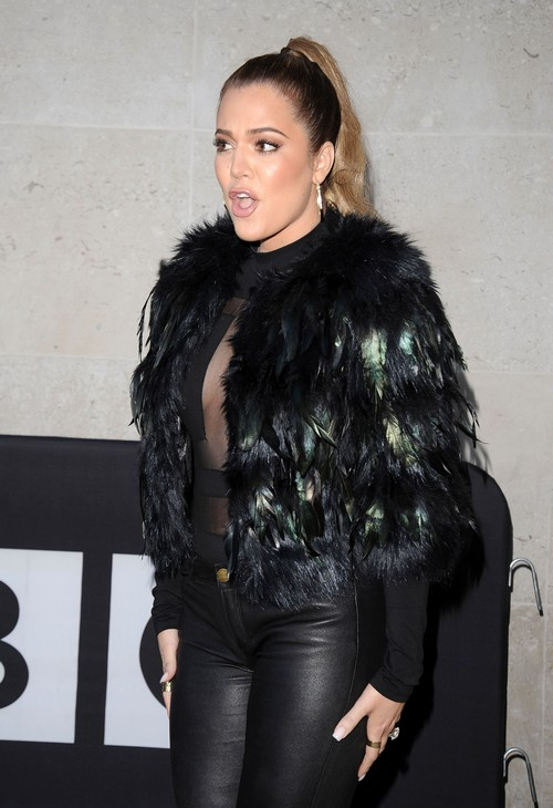 Khloe Kardashian Shows Ridiculous Fashion Sense With Leather, Sheer, And Feathers (PHOTOS)