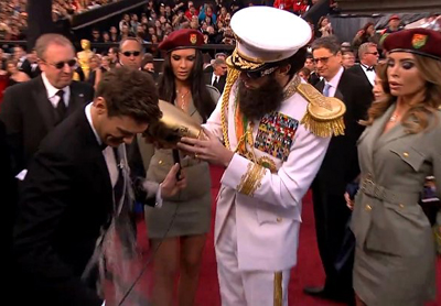 Sacha Baron Cohen To Ryan Seacrest: Sorry, I Meant To Throw The Ashes On Clooney!