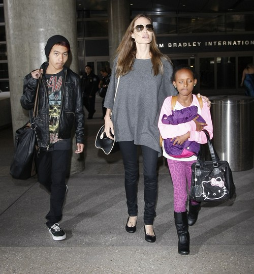 Angelina Jolie, Ryan Reynolds, Tom Cruise All Call Paparazzi To Create Public Image