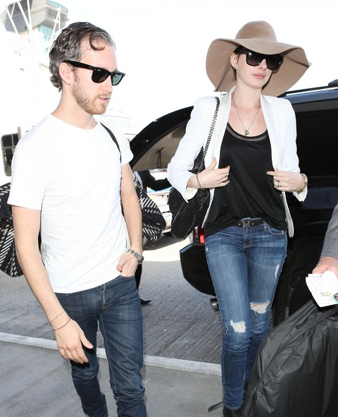 Anne Hathaway & Adam Shulman Departing On A Flight At LAX