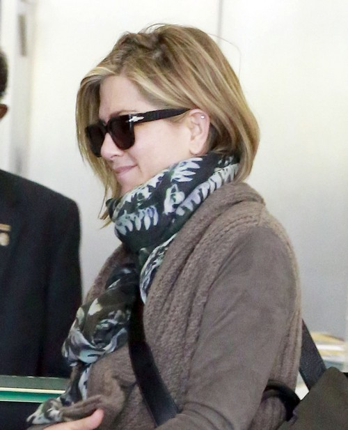 Jennifer Aniston MIA While Justin Theroux Kisses Sting's Wife, Trudie Styler