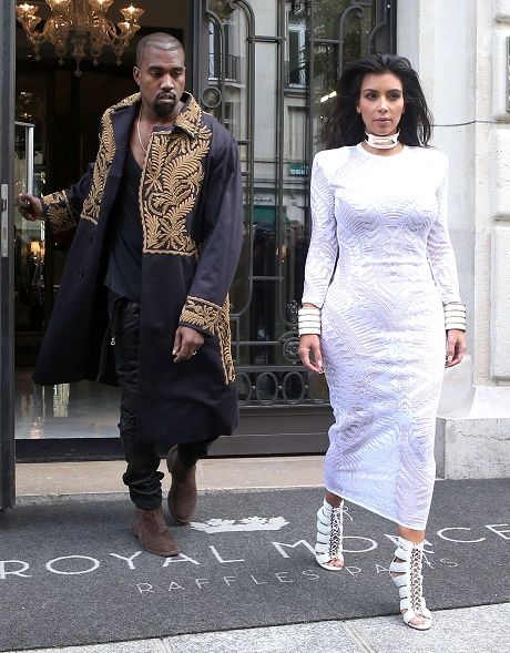Kim Kardashian Assaulted, Tackled At Paris Fashion Week Event - Paparazzi Protect Her From Attacker!