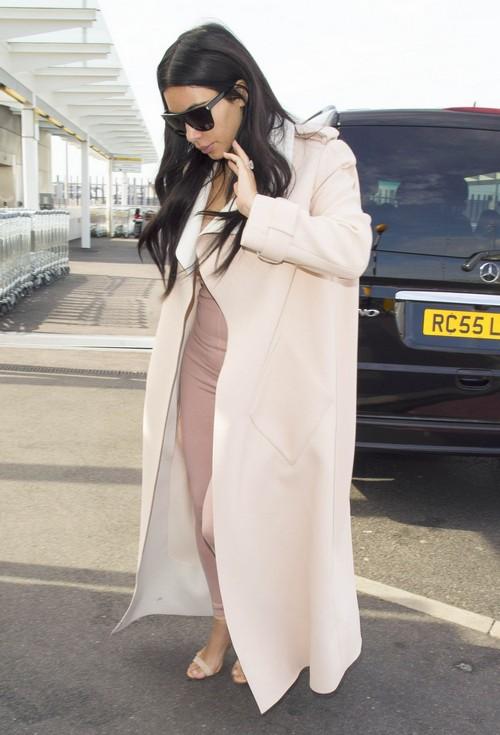 Kim Kardashian Divorce: Kanye West Furious As Flags Made of Ray-J Sex Tape: Kim Flies Home Without Husband