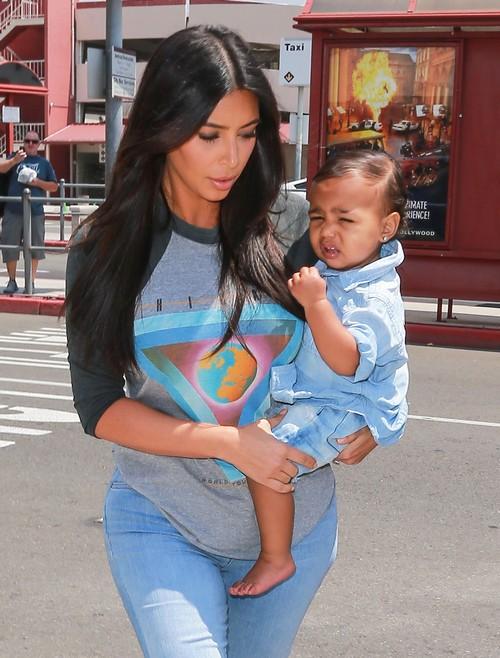 Kim Kardashian Holding North West in New Pics - Nori Looks Miserable (PHOTOS)