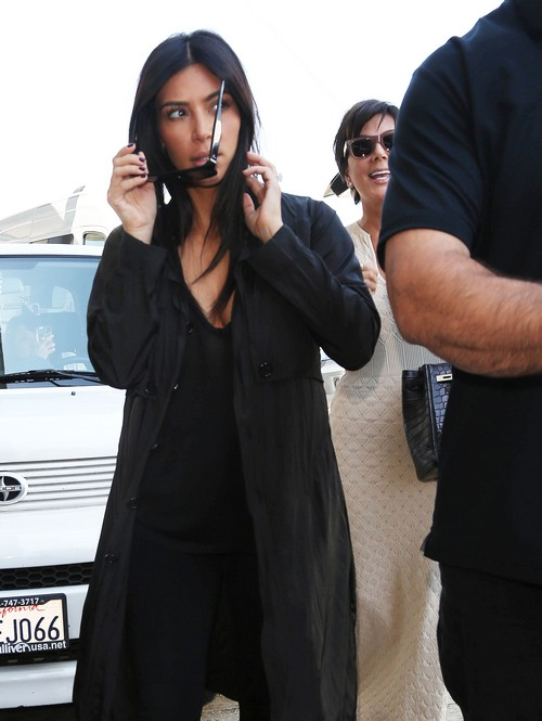 Kim Kardashian Appears Pregnant - Shows Weight Gain, Possible Baby Bump and Pregnancy Bloat (PHOTOS)