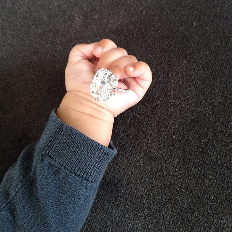 Kim Kardashian Posts Photo of North West holding her Giant Engagement Ring! (PHOTO)