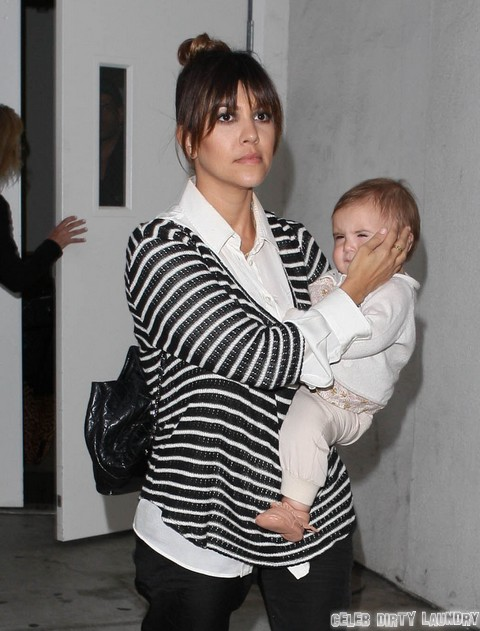 Khloe, Kourtney, and Penelope Arriving On A Flight At LAX
