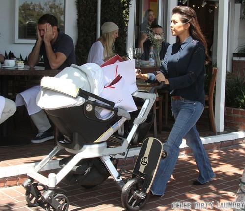 Kourtney Kardashian Looks Pregnant - Hiding Baby Bump In Latest Photos?