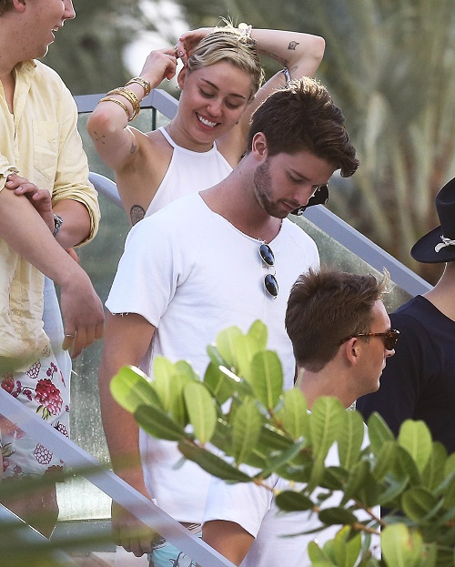 miley dating arnold son Do you know where your miley cyrus is according to e news, she's with arnold schwarzenegger's pizza king son, 21-year-old patrick.