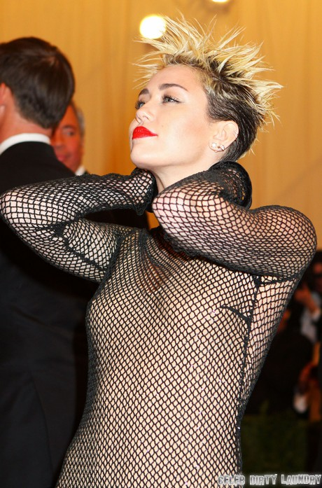 Miley Cyrus Beats January Jones in Face to Face Battle Over Liam Hemsworth