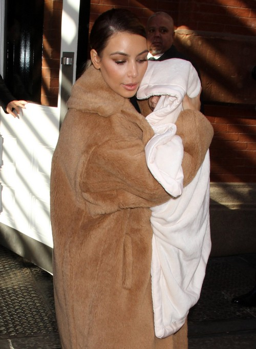 Kim Kardashian Exposes North West's Face While Wearing See-Through Top (PHOTOS)