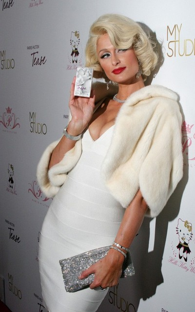 Paris Hilton dressed as a man trying to look like Marilyn Monroe at club My