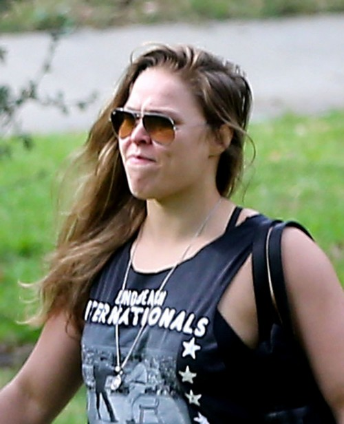 Ronda Rousey Emerges with Boyfriend Travis Browne: Terrified of Holly Holm Rematch After Face Destroyed (PHOTOS)