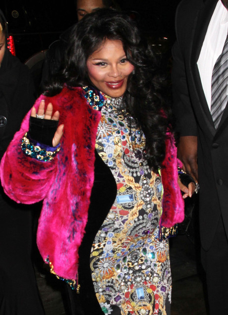 Lil' Kim Reveals Baby Bump At Mercedes-Benz New York Fashion Week: Who's The Baby's Daddy? (PHOTOS)