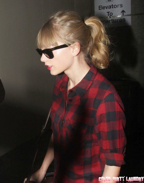 Taylor Swift Arriving On A Flight At LAX