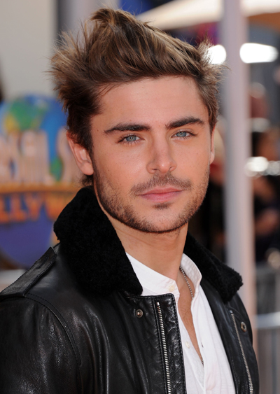 How Embarrassing! Zac Efron Drops A Condom Out Of His Pocket On The Red Carpet (Video)