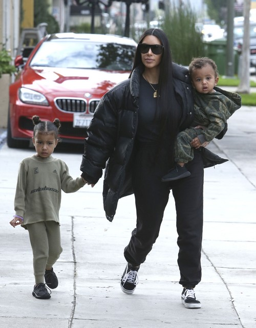 52319772 Reality stars Kim and Kourtney Kardashian take their kids to have lunch with Kim's husband Kanye West at Something's Fishy in Woodland Hills, California on February 19, 2017. The family was bundled up against the cold winter weather. FameFlynet, Inc - Beverly Hills, CA, USA - +1 (310) 505-9876