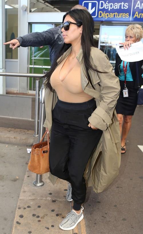 Pregnant Kim Kardashian Lands In Nice