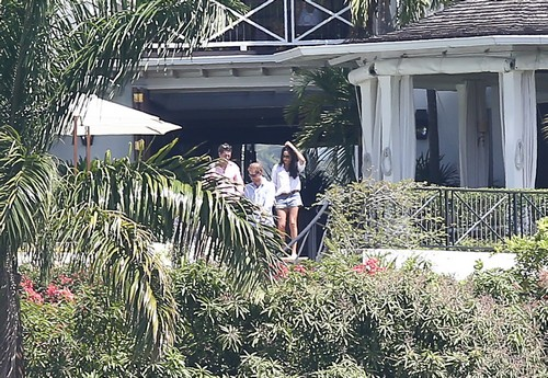 52334929 Prince Harry was spotted at a beach in Jamaica on March 4, 2017 with friends. Harry and Meghan are on vacation attending a friends wedding. FameFlynet, Inc - Beverly Hills, CA, USA - +1 (310) 505-9876