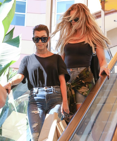 52153494 Reality stars Kourtney Kardashian and Khloe Kardashian go shopping at the mall in Encino, California on August 23, 2016. The two had bags full of purchases, but before leaving took a ride on the merry go round. FameFlynet, Inc - Beverly Hills, CA, USA - +1 (310) 505-9876