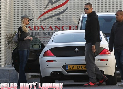 Paris Hilton At The Airport in France With DJ Afrojack - Photos