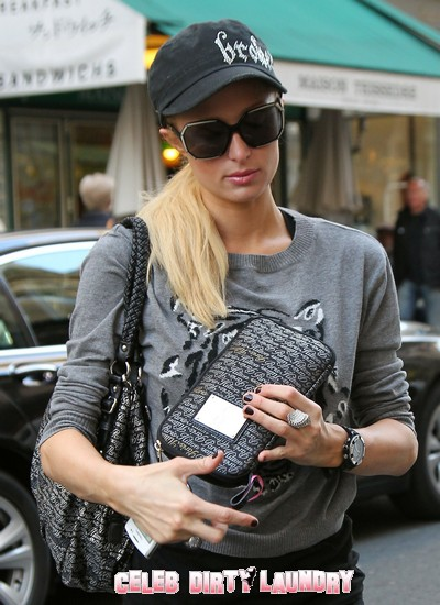 Paris Hilton Shows Off Her Own Brand While Shopping In Paris, France Today (Photos)