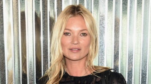 Kate Moss Sunbathing Shows off her curvy physique