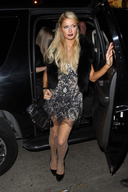 Gorgeous Paris Hilton enjoys a night out with her sister Nicky at the Chateau Marmont in Los Angeles